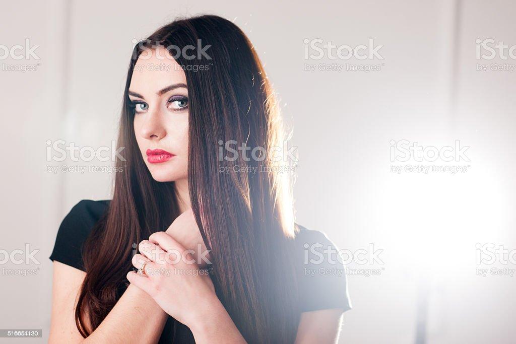 Self confident woman in black dress stock photo
