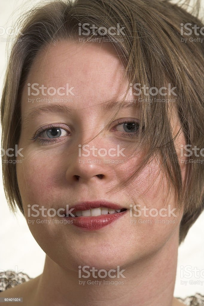 self confident woman with wind blown hair royalty-free stock photo