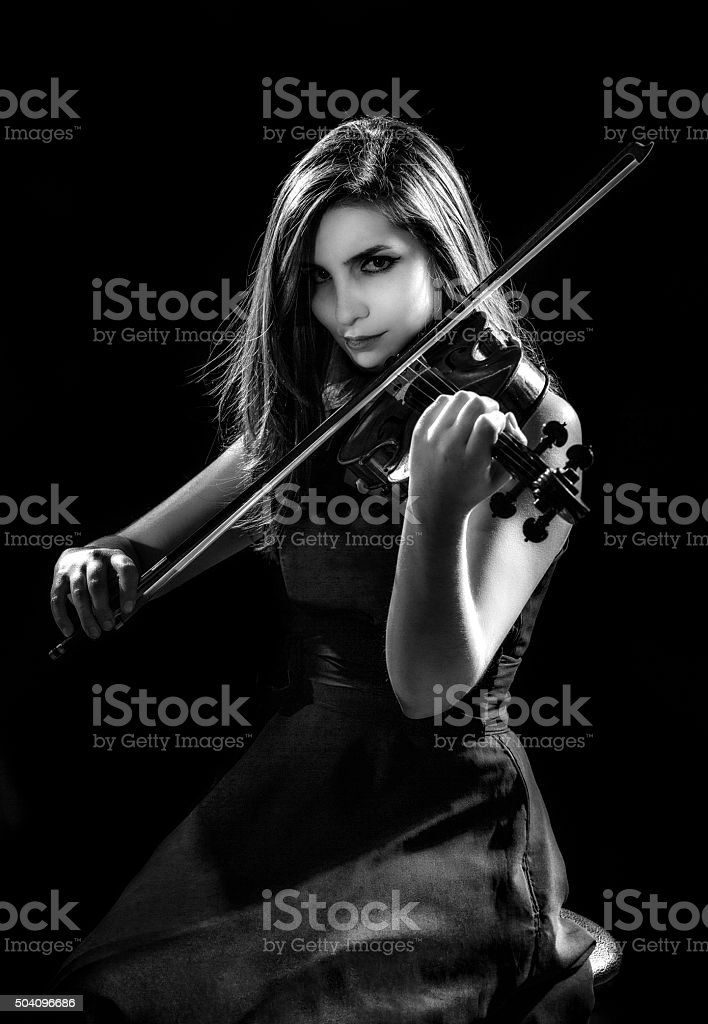 Self confident young woman and violinist player during presentation stock photo