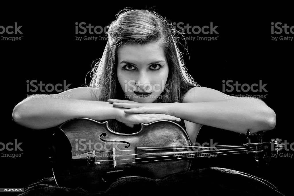 Self confident young woman posing with her violin stock photo