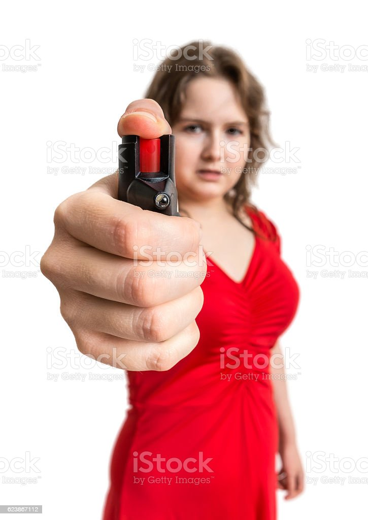 Self defense concept. Young woman holds pepper spray in hand. stock photo