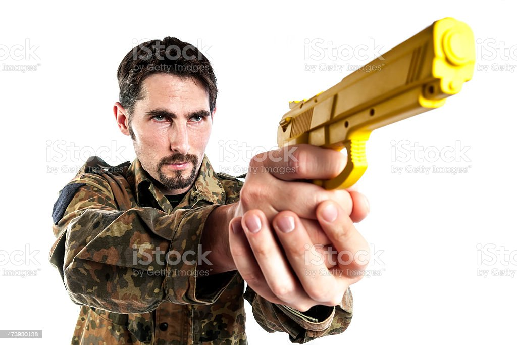 Self defense instructor with training gun stock photo