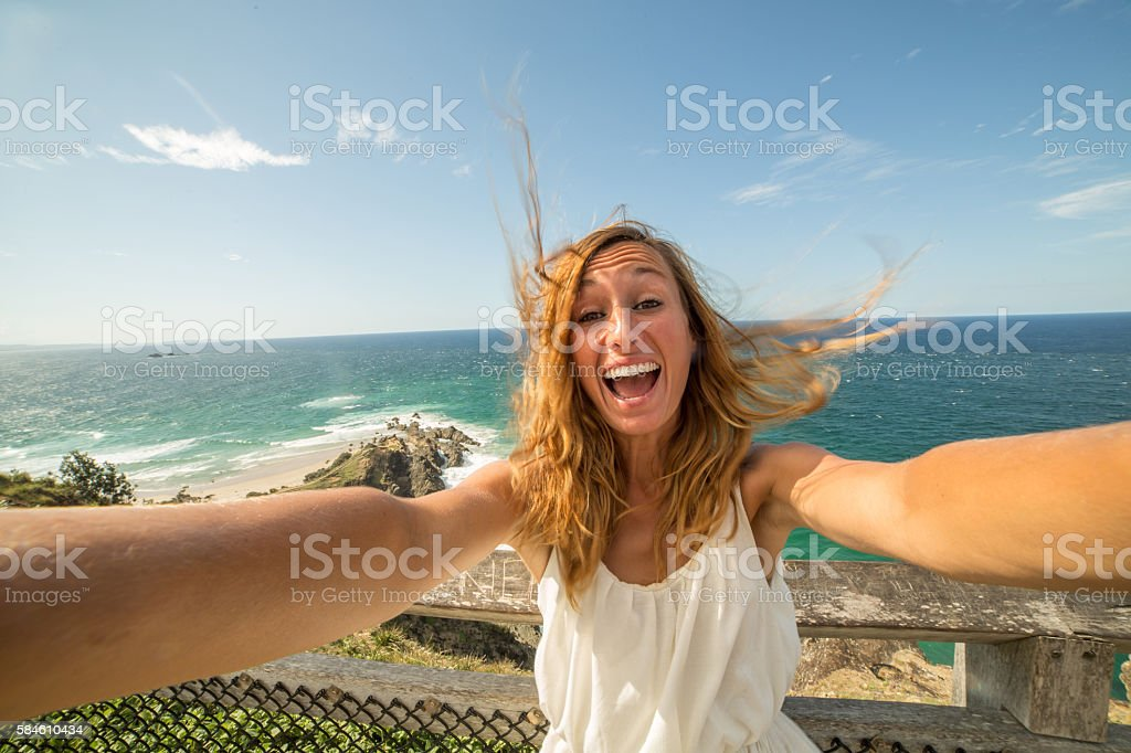 Self portrait of a young woman on a cliff, summer stock photo