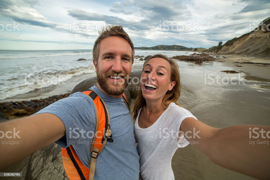 Self portrait of young couple at the Moeraki boulders-New Zealand stock photo