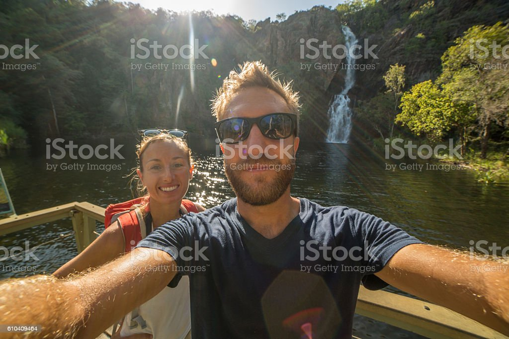 Self portrait of young couple at the waterfalls stock photo