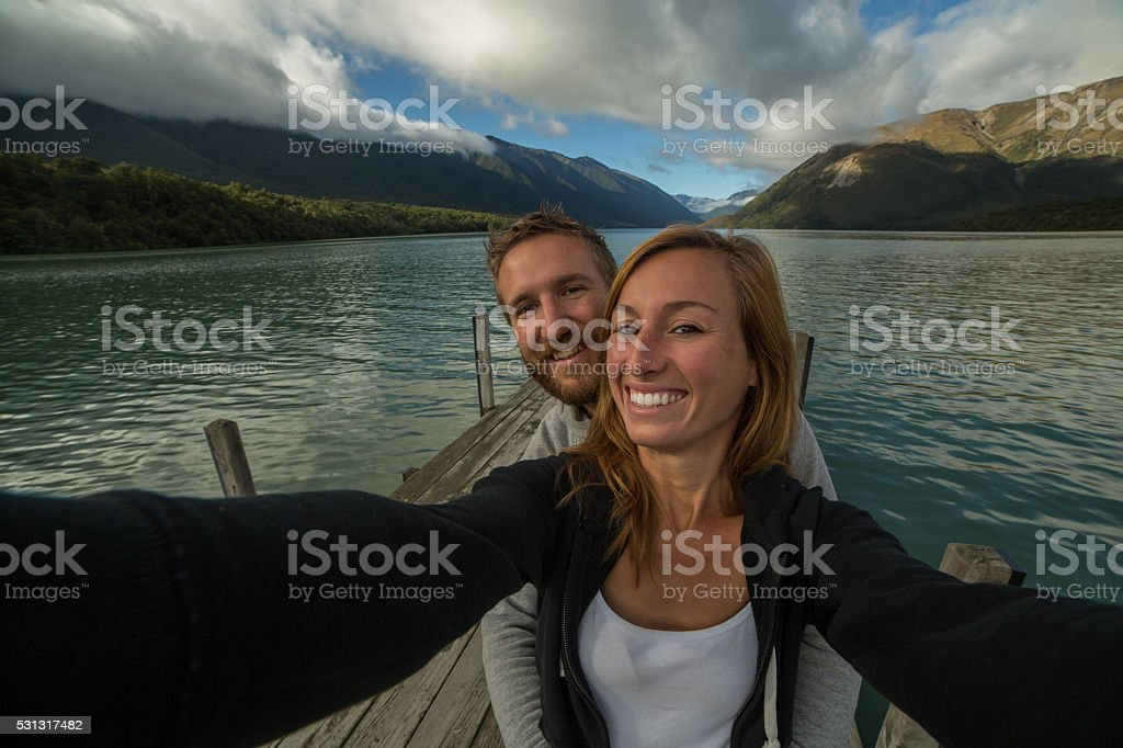 Self portrait of young couple capturing vacation moments stock photo