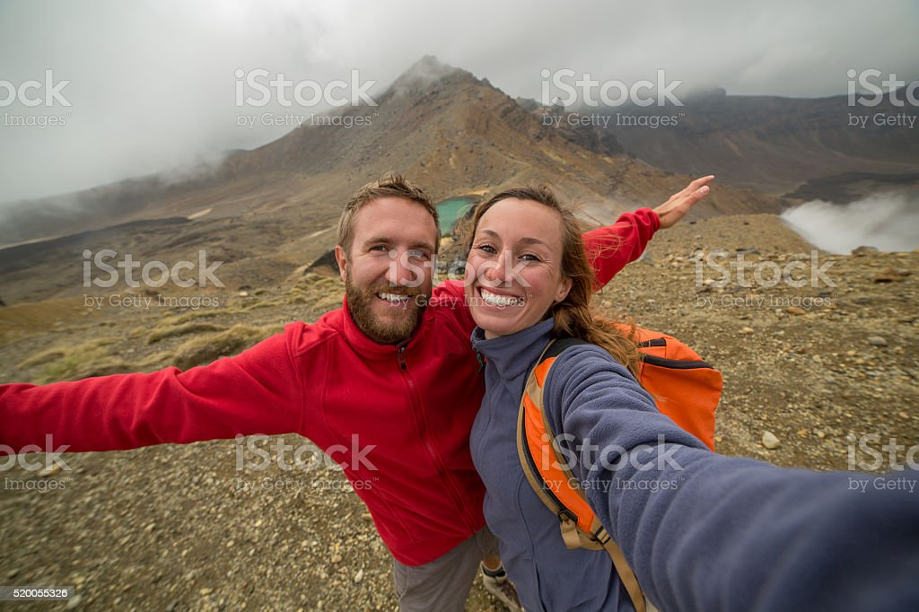 Self portrait of young couple hiking in New Zealand stock photo