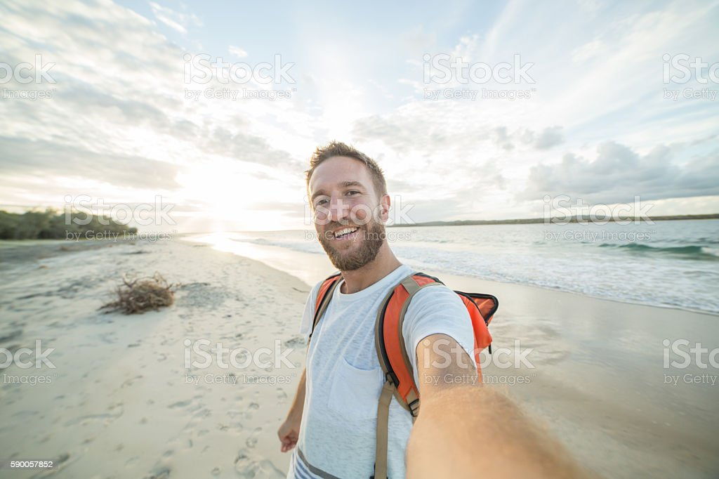Self portrait of young man by the beach stock photo