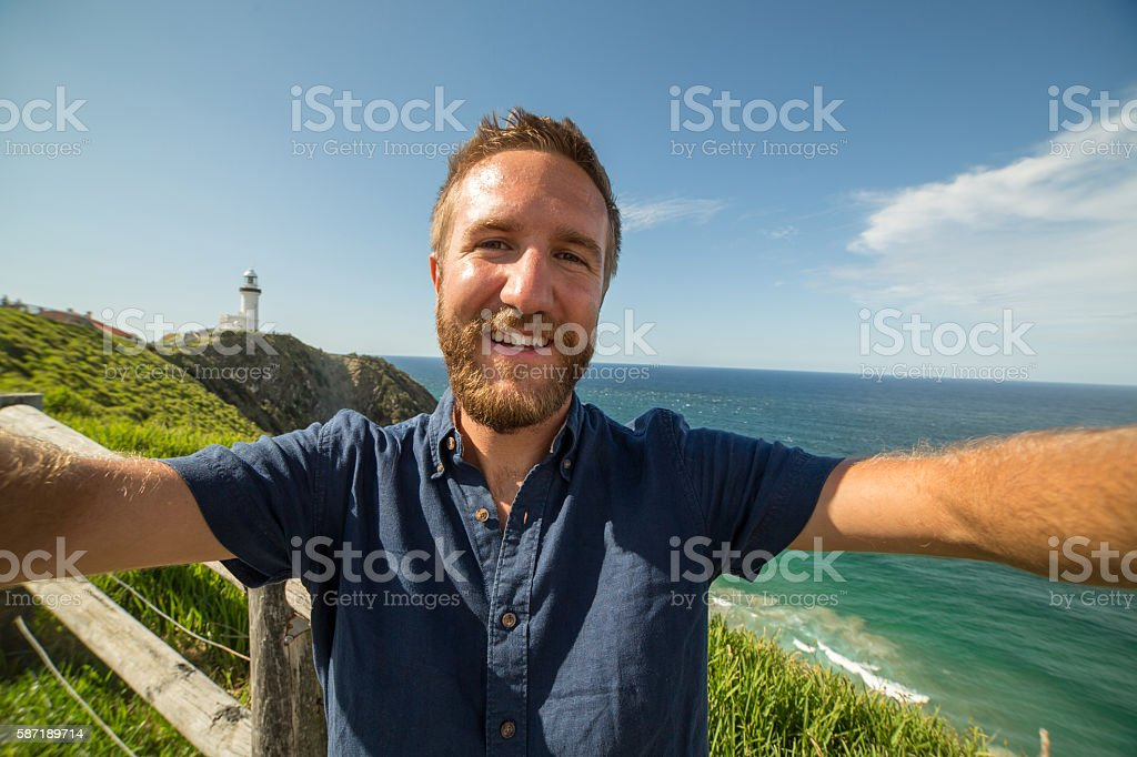 Self portrait of young man by the sea stock photo