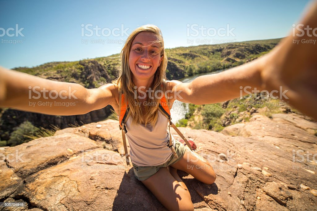 Self portrait of young woman in nature stock photo
