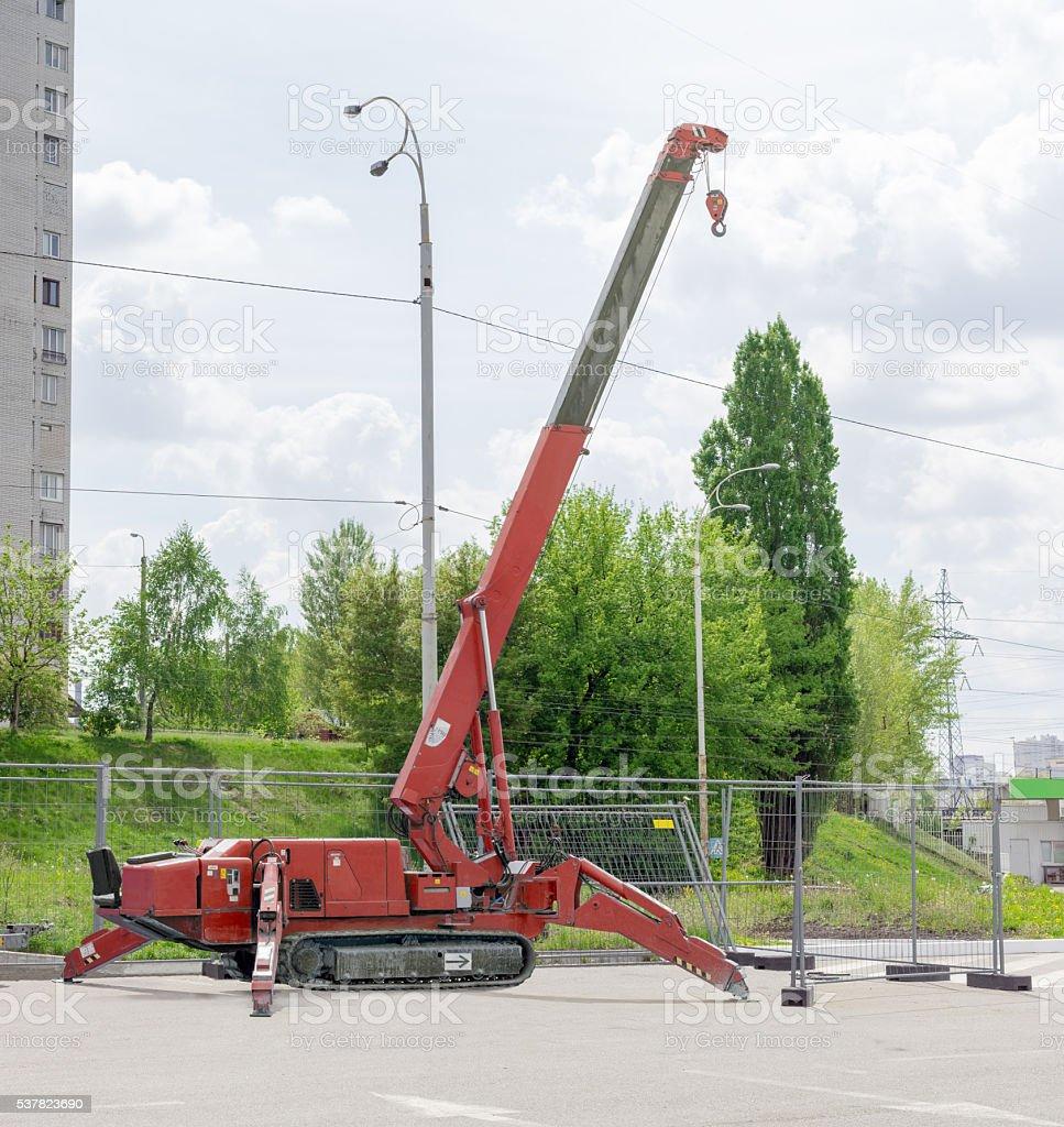 Self propelled crawler crane with telescoping boom on asphalt si stock photo