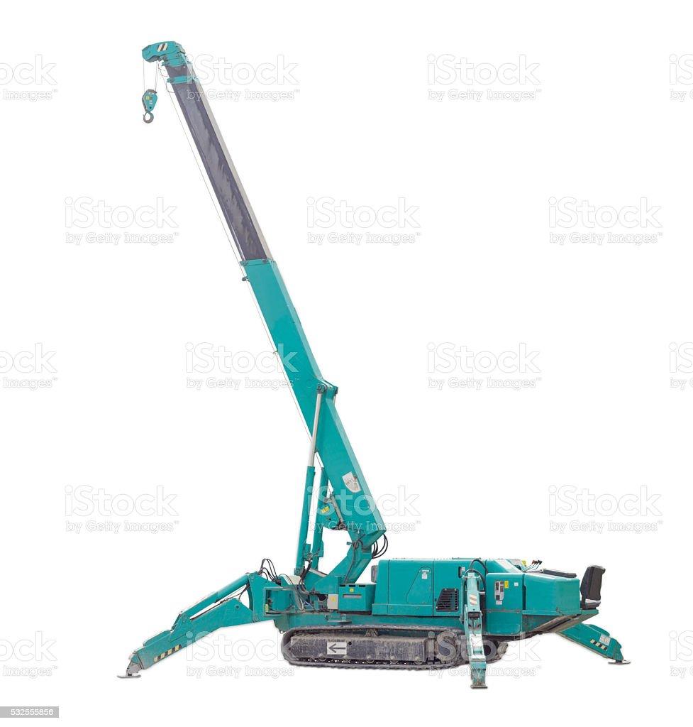 Self propelled crawler crane with telescoping boom on light back stock photo