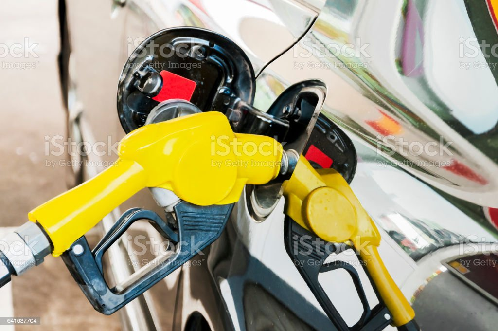 Self service FUEL Pump in oil station stock photo