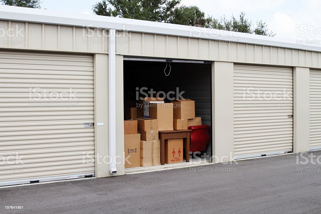 Self storage warehouse with single storage unit open to stock photo