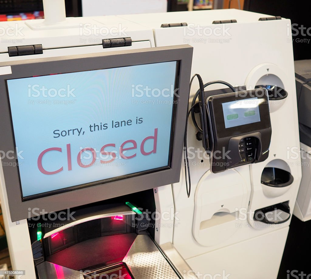 A supermarket self-checkout lane machine till with a closed sign...