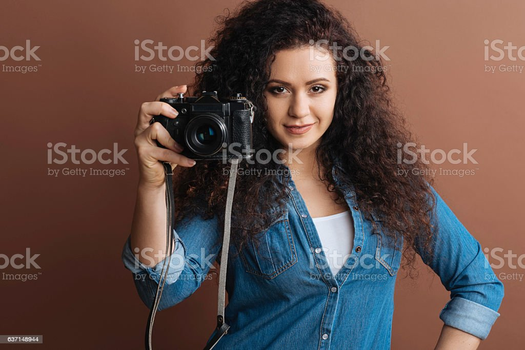 Self-confident lady being in the mood for shooting stock photo