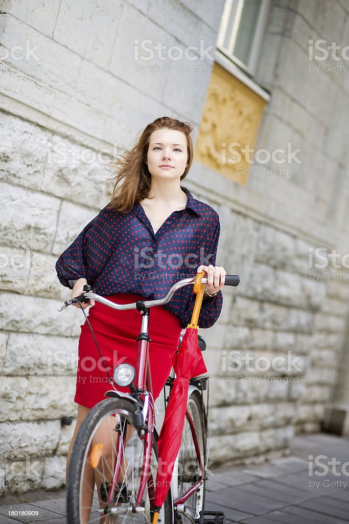Self-confident woman in red skirt royalty-free stock photo