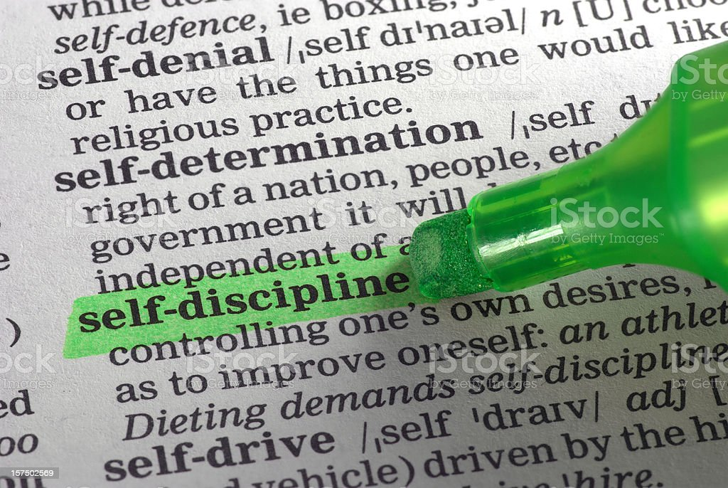 self-discipline highligted in dictionary stock photo