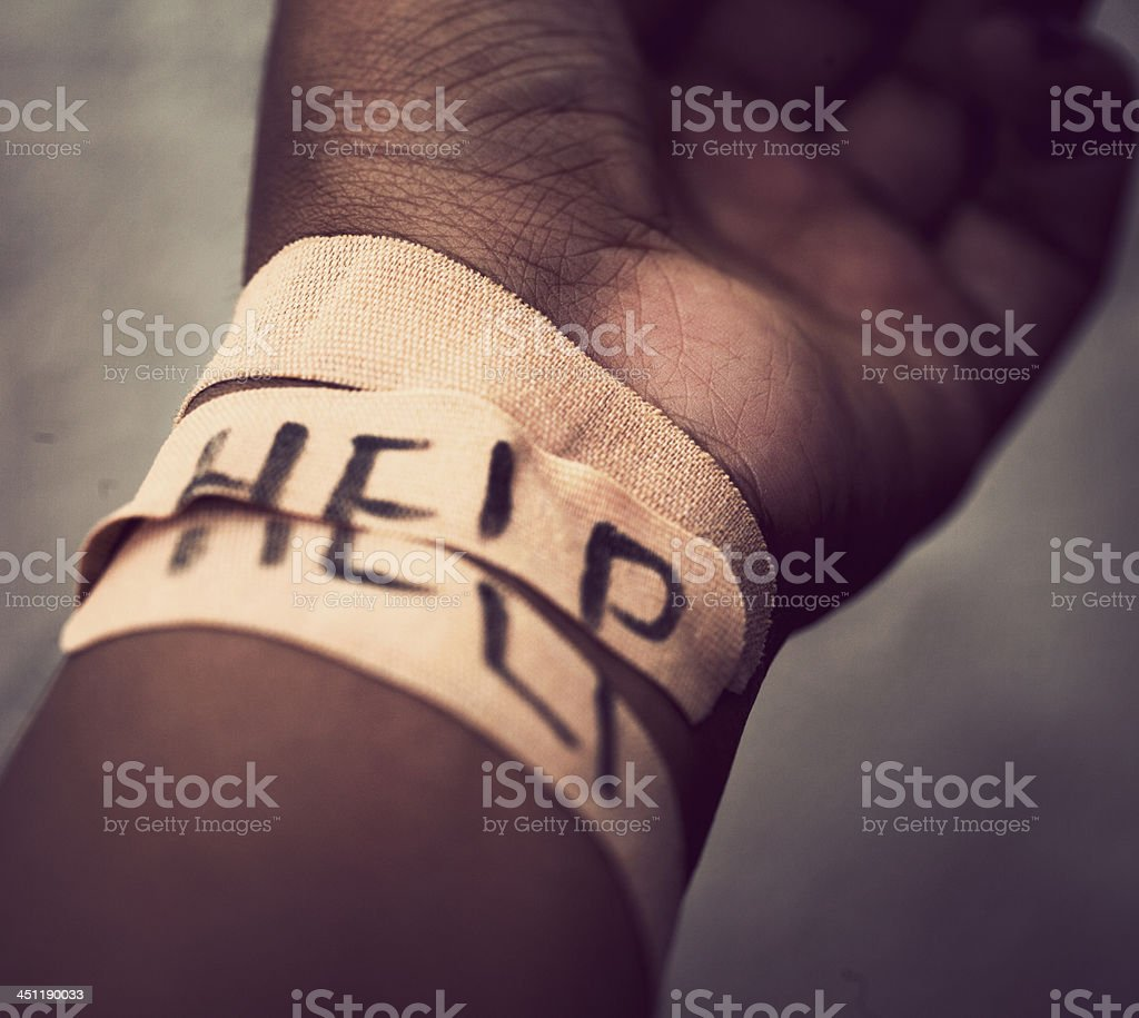 Self-harm wrist covered with bandage stock photo