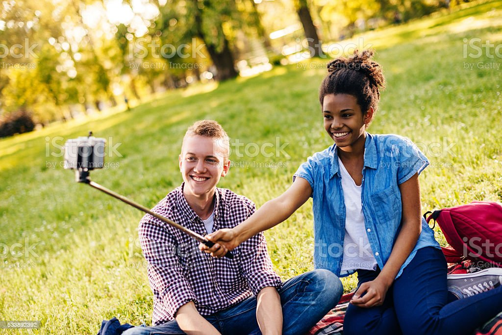 Selfie after school during picnic in park. stock photo