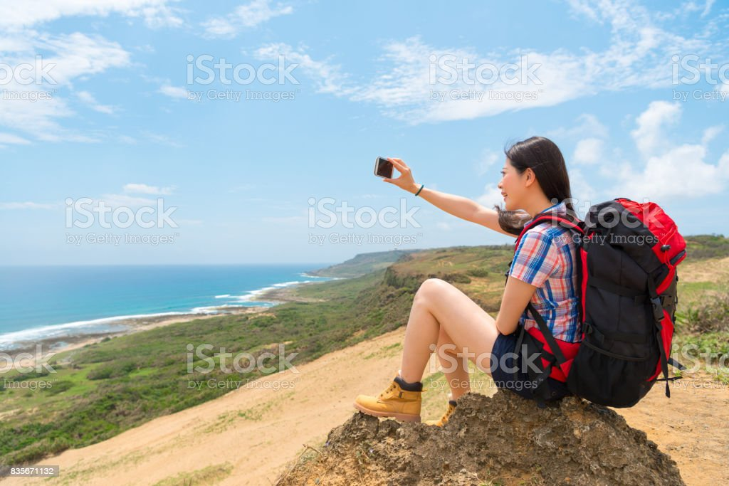 selfie backpacker tourist sitting on the mountain stock photo