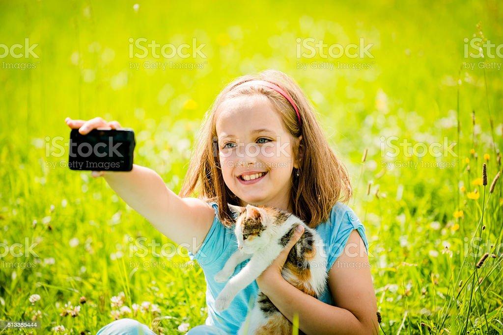 Selfie child and cat stock photo