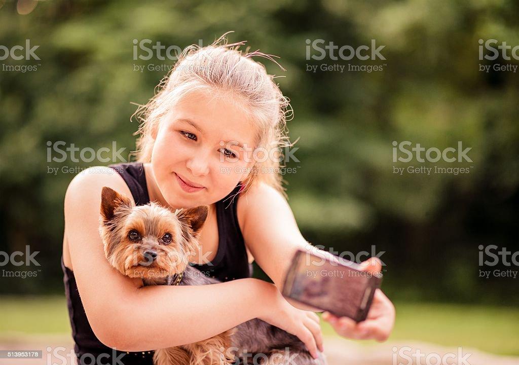 Selfie child and dog stock photo