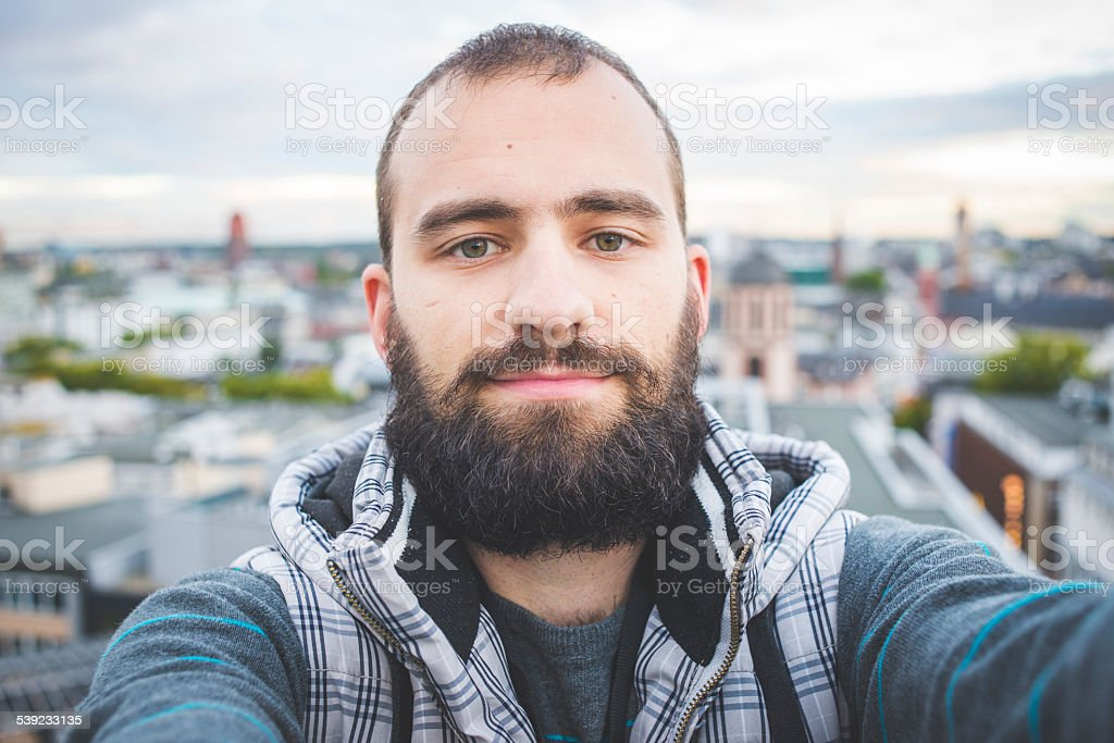 Selfie from the roof of the building stock photo