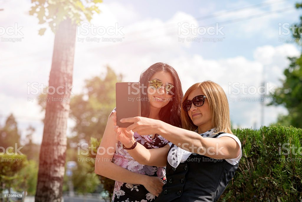 Selfie girls taking photos with a digital tablet stock photo