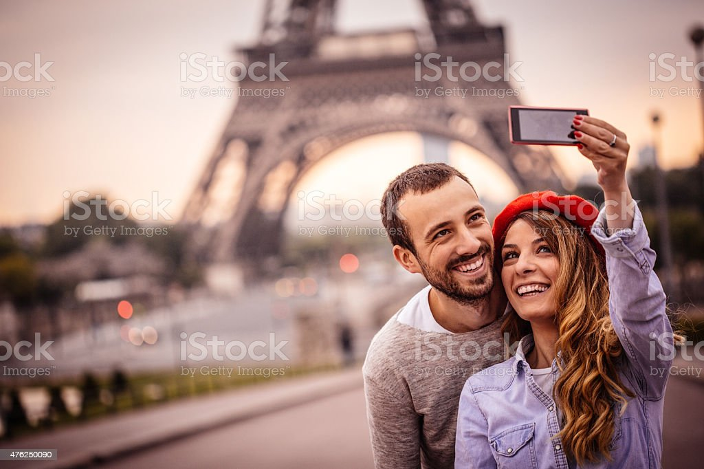 Selfie in front of the Eiffel Tower stock photo