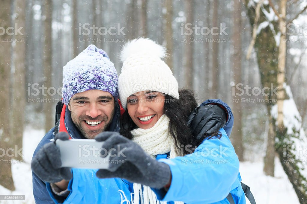 Selfie in the snow forest stock photo