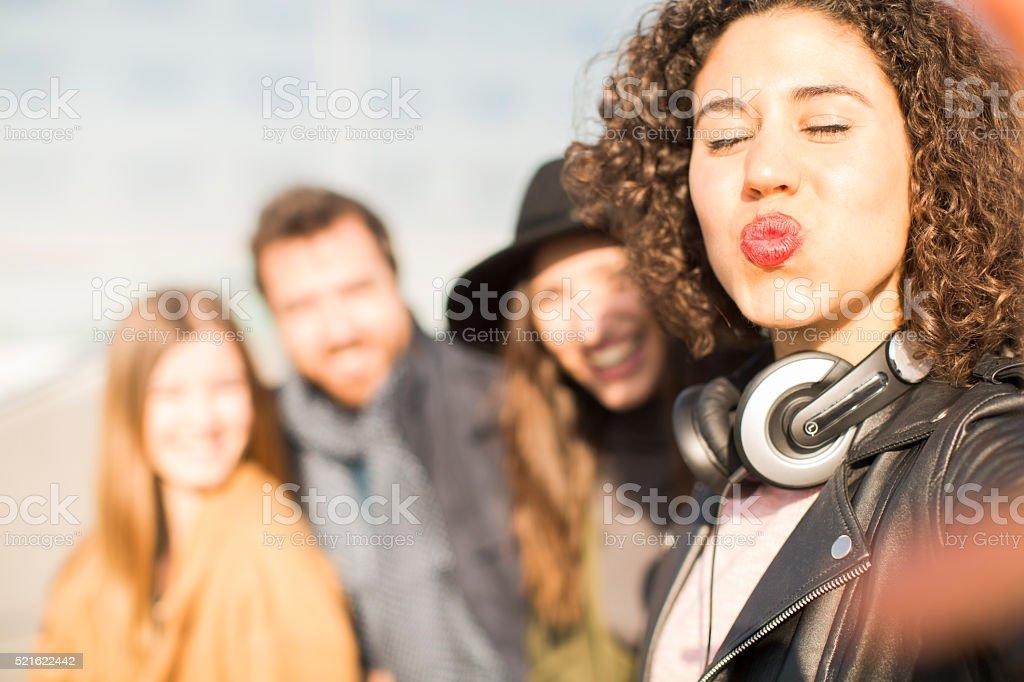 Selfie kiss group of friends enjoying Barcelona. stock photo