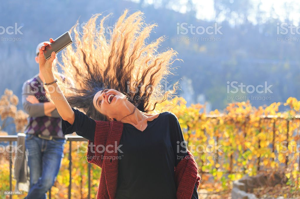 Selfie of happy young woman - hair toss stock photo
