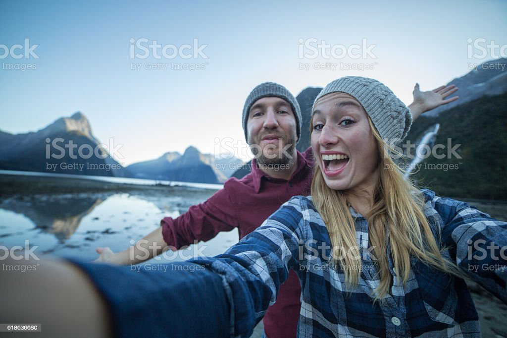 Selfie of young couple hiking stock photo