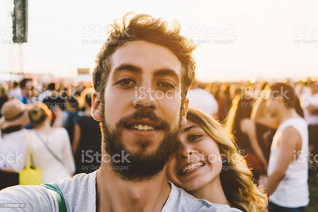 Selfie of young couple on festival stock photo