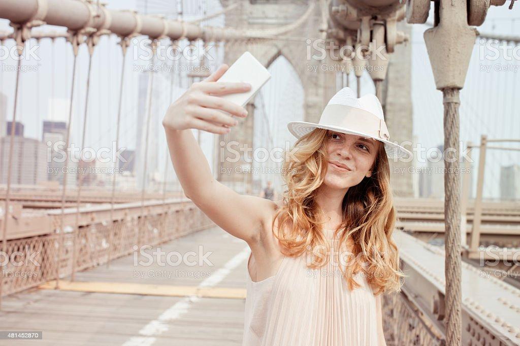 Selfie on Brooklyn Bridge stock photo