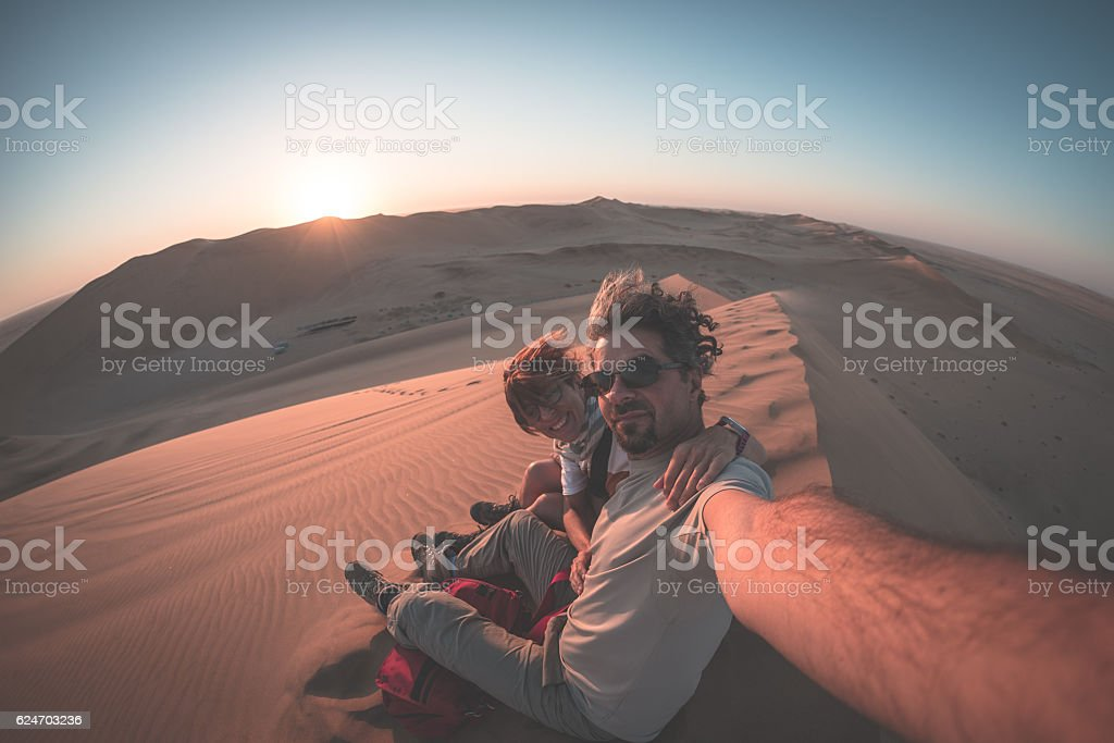 Selfie on sand dunes in the Namib desert, Namibia, Africa stock photo
