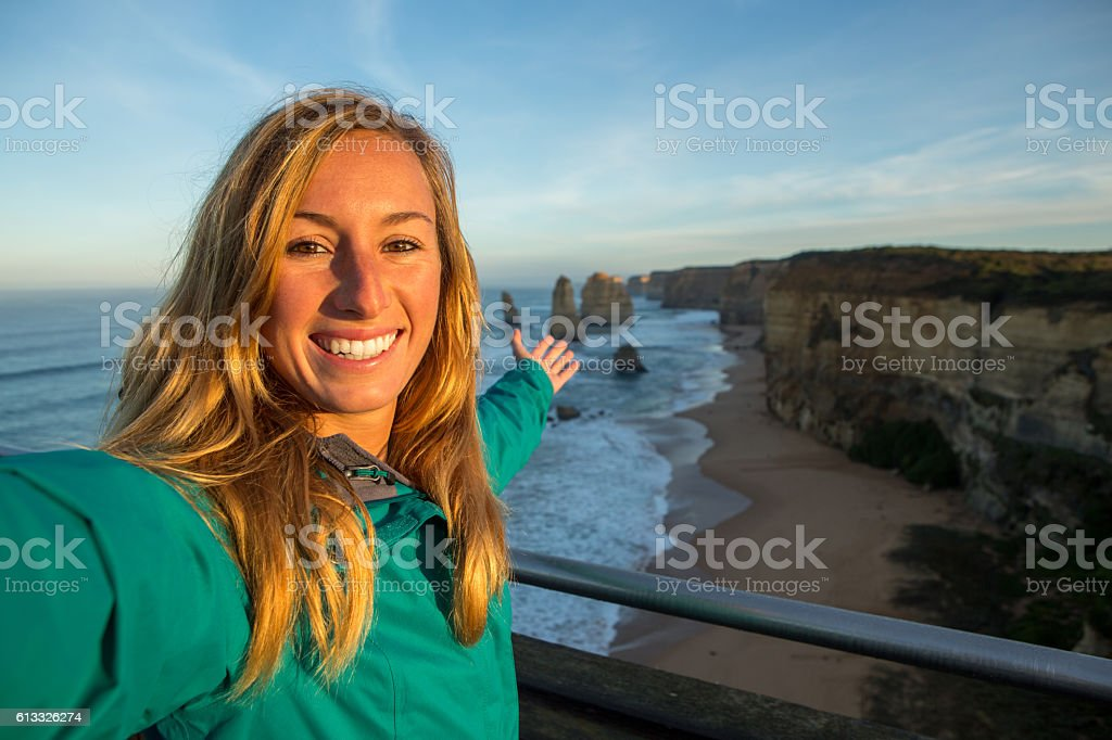 Selfie portrait at sunrise of woman at the Twelve Apostles stock photo
