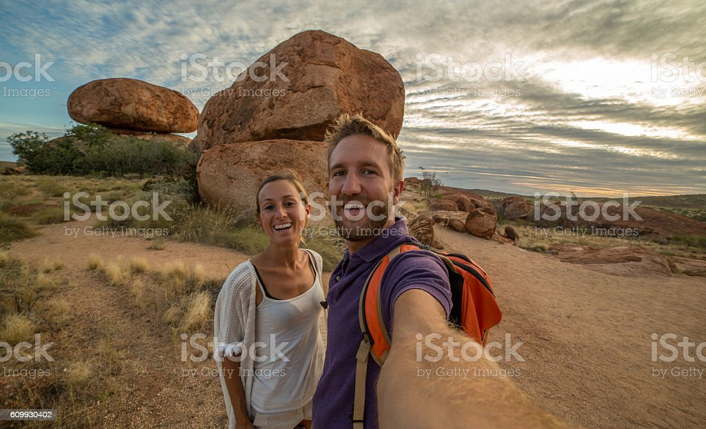 Selfie portrait of two young adults at the Devil's Marbles stock photo