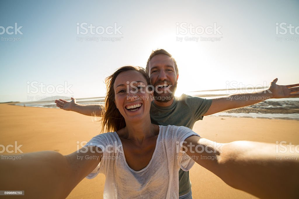 Selfie portrait of young happy couple stock photo