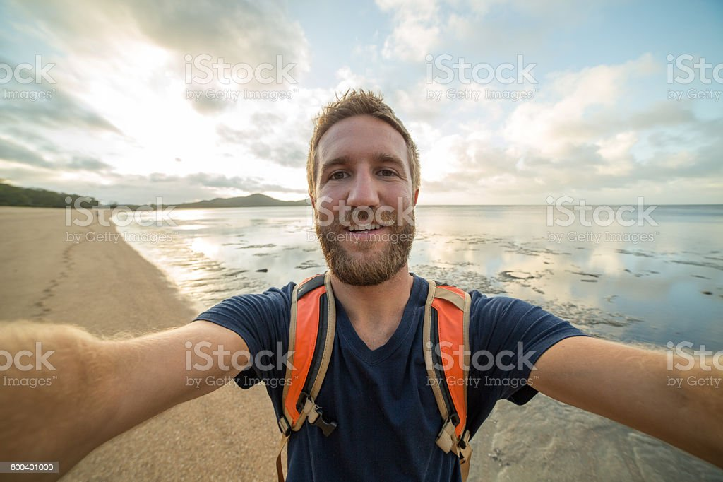 Selfie portrait of young man traveling the world stock photo