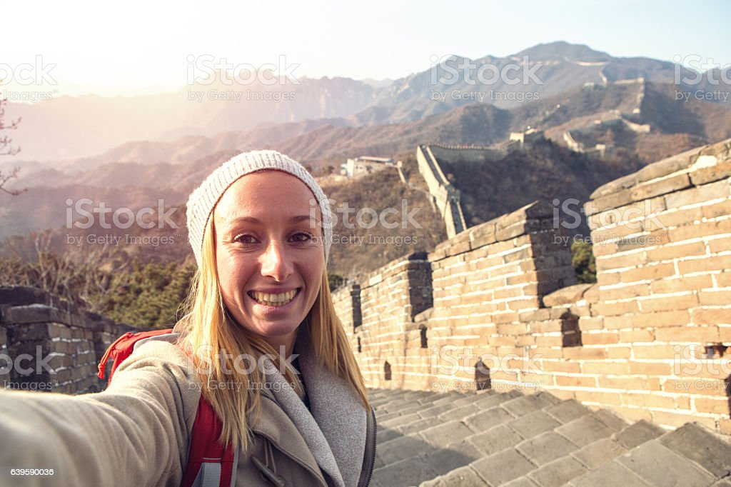 Selfie portrait of young woman on Great Wall of China stock photo