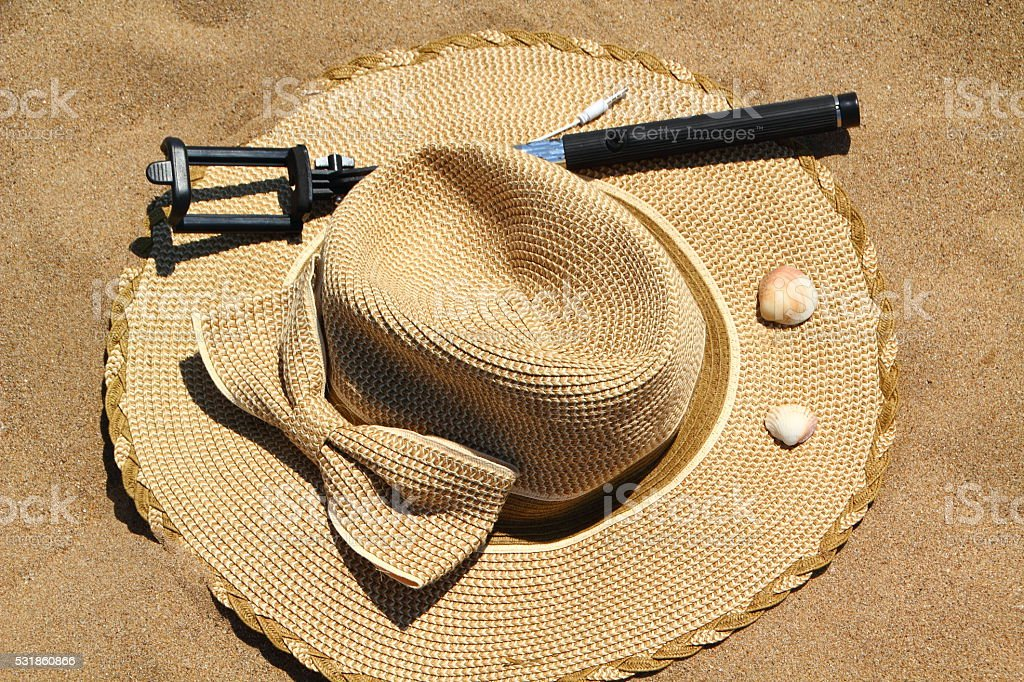 selfie stick and summer hat stock photo