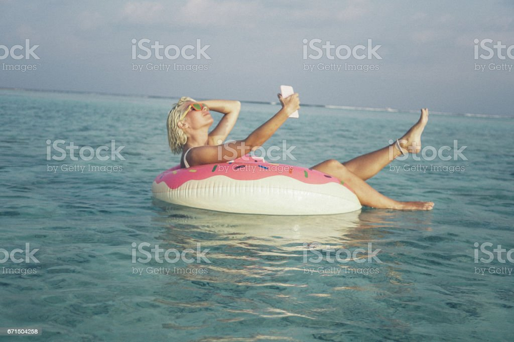 Selfie time and floating, Maldives stock photo