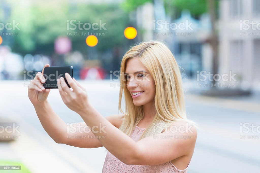 Selfie time during city trip stock photo