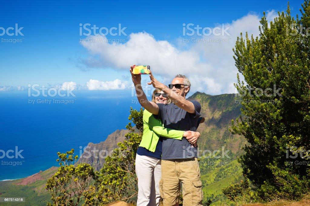 Selfie Tourist Couple at Waimea Canyon State Park Kalalau Beach, Kauai, Hawaii stock photo