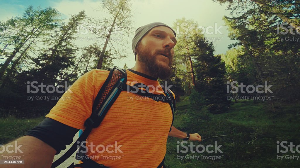 POV Selfie trail running on the mountain stock photo