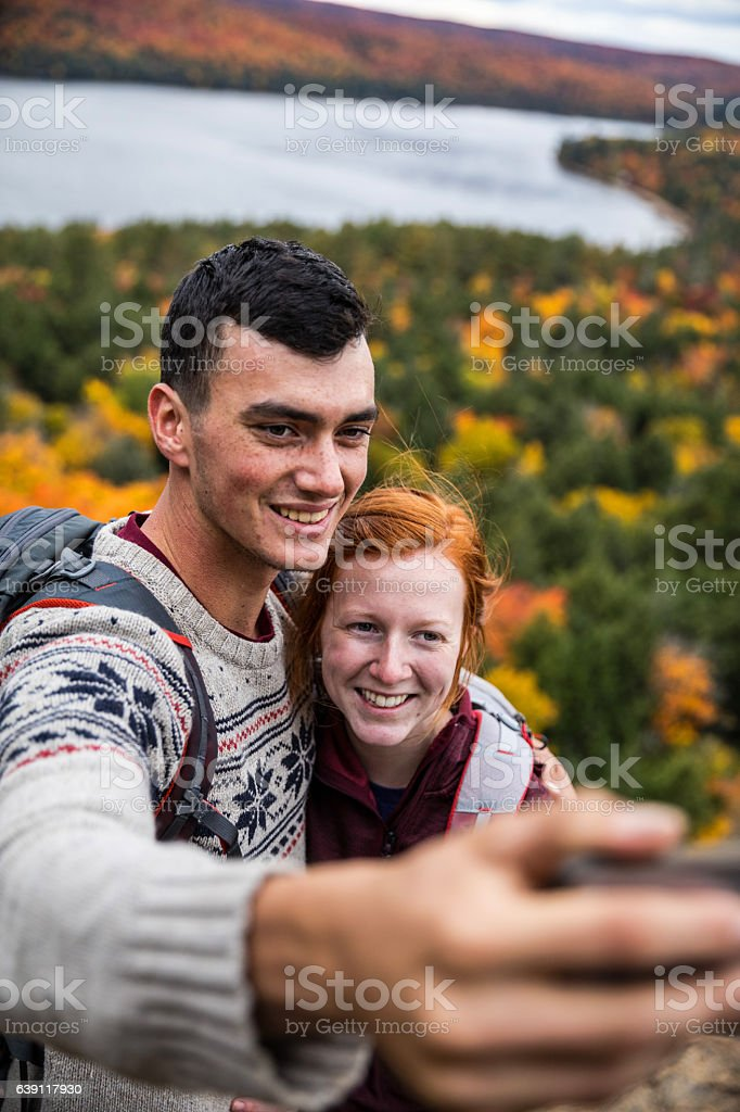 Selfie with a view on a mountain peak in Canada stock photo