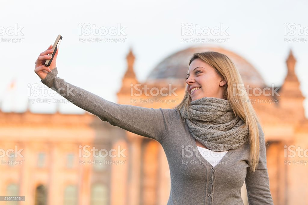 Selfie with Bundestag of Berlin on background stock photo