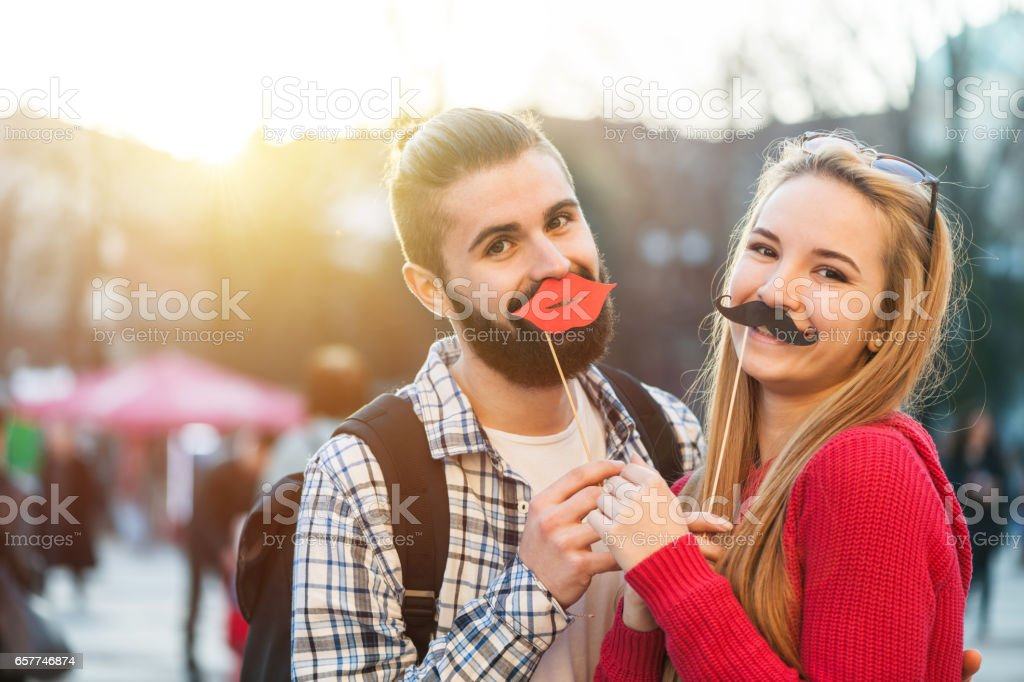 Selfie with fake mustaches and lips stock photo